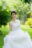 Chinese bride with wedding dress Royalty Free Stock Photography