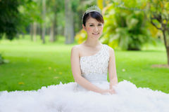 Chinese bride with wedding dress Royalty Free Stock Photo