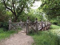Chinese bridge. The Chinese bridge at the crossing point of two lakes in the grounds of Wimpole Hall. They were first started in 1697 and gradually extended Royalty Free Stock Image