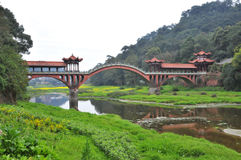 CHINESE bridge. Chinese Arch bridge characteristics red reflection river green crops canola flower Stock Photos