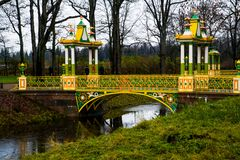 Chinese bridge over small stream. Autumn.Russia,the town of Pushkin, Tsarskoe Selo. Alexander park. Stock Images