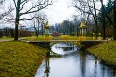 Chinese bridge over small stream. Autumn.Russia,the town of Pushkin, Tsarskoe Selo. Alexander park. Stock Image