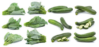 Chinese broccoli and fresh zucchini isolated on white background Stock Photos