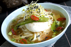 Chinese broth with poached egg Stock Photo