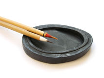 Chinese brushes calligraphy. A photo of chinese writing materials -a  pair of bamboo made chinese calligraphy, drawing or paint brushes, arranged neatly on an Stock Photo