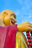 Chinese Buddha on white. Statues of Chinese deities on sky Stock Photography