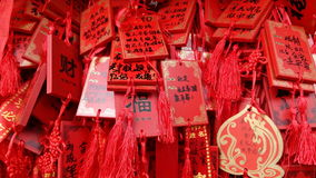 Chinese Buddhist prayers on red plates Stock Photography