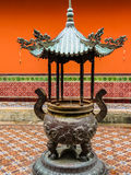 Chinese Buddhist Temple in Singapore. Pot for the burning sticks. Detail of Chinese Buddhist Temple royalty free stock photo