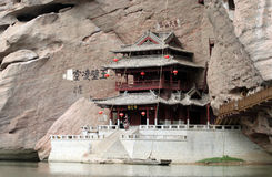 Chinese building on cliff. Chinese building on riverside ledge and cliff Royalty Free Stock Photography