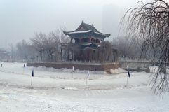 Chinese building on frozen lake in Urumqi stock image