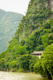 Chinese building in lush jungle Stock Photos