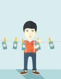 Chinese buisnessman hang his money Stock Photos