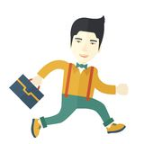 Chinese Buisnessman walking with his briefcase Stock Photo