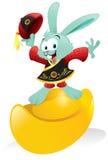 Chinese Bunny Riding Gold Ingot Stock Images