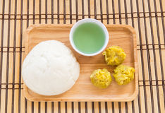Chinese buns and dumpling in wooden plate Royalty Free Stock Photo