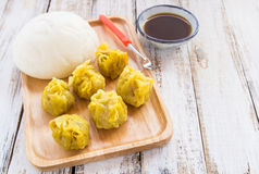 Chinese buns and dumpling in wooden plate Royalty Free Stock Photos