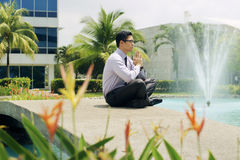 Chinese Business Man Meditate Yoga Outside Office Building Stock Photography