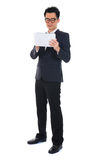 Chinese business man using tablet Stock Photo