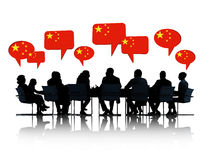 Chinese Business People Having a Meeting Royalty Free Stock Photos