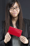 Chinese business woman holding a red packet Royalty Free Stock Photo