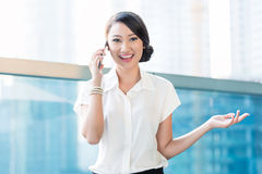 Chinese Business woman in telephone call. Taken on terrace of office building outdoors Stock Photography