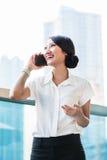 Chinese business woman using phone Stock Photo