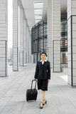 Chinese business women with suitcase Stock Photography