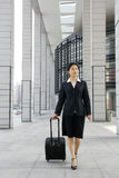 Chinese business women with suitcase stock image