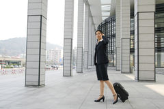 Chinese business women with suitcase Stock Photo