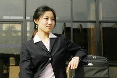 Chinese business women with suitcase. Young chinese business women with suitcase Stock Images