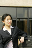 Chinese business women with suitcase. Young chinese business women with suitcase Royalty Free Stock Photo