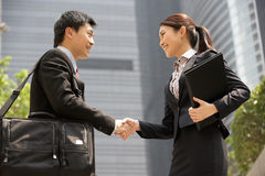Chinese Businessman And Businesswoman Stock Photo
