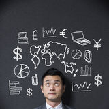 Chinese businessman in front of a diagram of business Stock Photography
