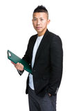 Chinese businessman holding clipboard Stock Image