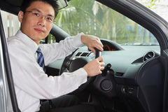 Chinese businessman inside car Royalty Free Stock Photos