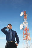 Chinese businessman on phone and antenna Royalty Free Stock Photos
