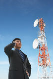 Chinese businessman on phone and antenna Royalty Free Stock Photography