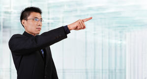 Chinese businessman pointing to empaty space Royalty Free Stock Images