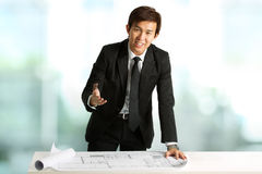 Chinese businessman presenting plans Stock Photo