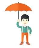 Chinese businessman with umbrella as protection Stock Images