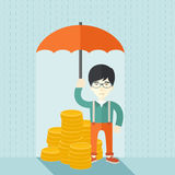 Chinese businessman with umbrella as protection Royalty Free Stock Images