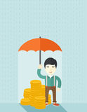 Chinese businessman with umbrella as protection Stock Photography