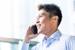 Chinese businessman using phone Royalty Free Stock Photo