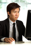 Chinese Businessman working in office Stock Image