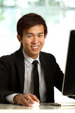 Chinese Businessman working in office Stock Photography