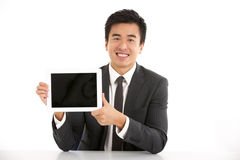 Chinese Businessman Working On Tablet Computer. Studio Shot Of Chinese Businessman Working On Tablet Computer Smiling Royalty Free Stock Photography