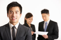 Chinese Businesspeople Discussing Document Royalty Free Stock Photos