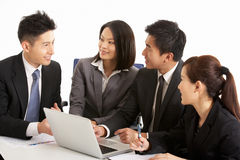 Chinese Businesspeople Having Meeting Stock Images