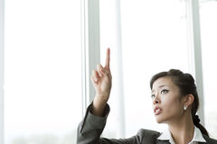 Chinese Businesswoman. Pointing at Copy-space Stock Image
