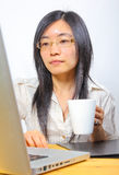 Chinese businesswoman drinking coffee royalty free stock photos